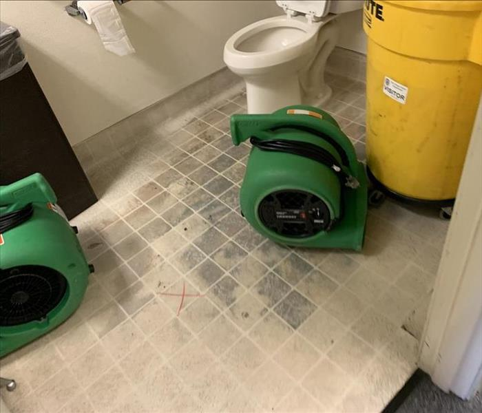 Repaired water loss in bathroom with dehumidifier