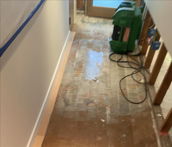 Floors being dried and repaired after water damage